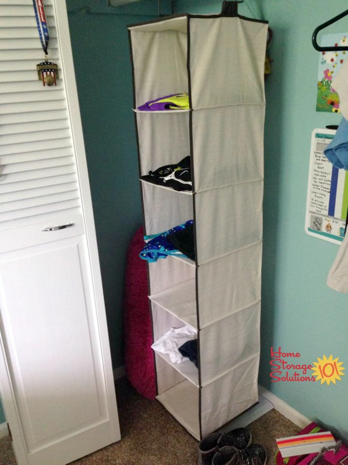Hanging closet organizer used to lay out 6 days worth of clothes, socks and accessories to make mornings less stressful {featured on Home Storage Solutions 101}