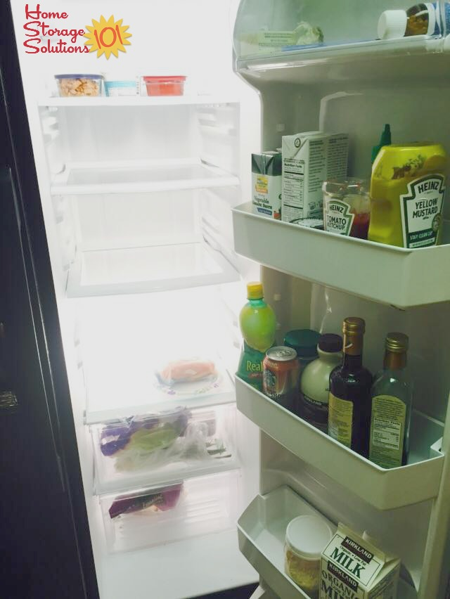 Mostly empty refrigerator after doing the #Declutter365 mission to get rid of old and expired food {on Home Storage Solutions 101}