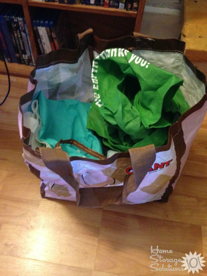 Decluttered reusable shopping bags that are ripped and torn {on Home Storage Solutions 101}