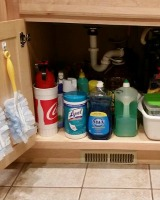 declutter under kitchen sink cabinet