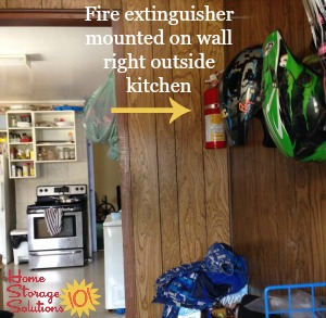 fire extinguisher placement by kitchen