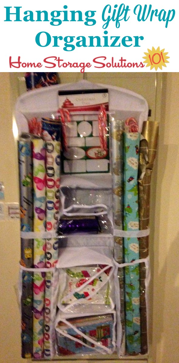 This hanging gift wrap organizer can keep your wrapping paper and accessories together in one handy location which is easily accessible, but still doesn't take up too much room in your closet {featured on Home Storage Solutions 101} #GiftWrapOrganizer #GiftWrapOrganization #GiftWrapStorage