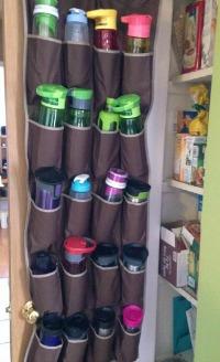 water bottle storage in over the door shoe organizer in pantry