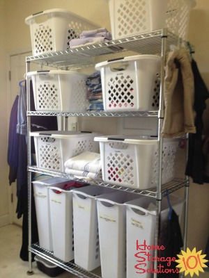 gathering and sorting all dirty laundry into laundry room