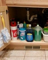 declutter under kitchen sink cabinet