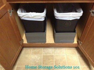 trash and recycling bin inside cabinet
