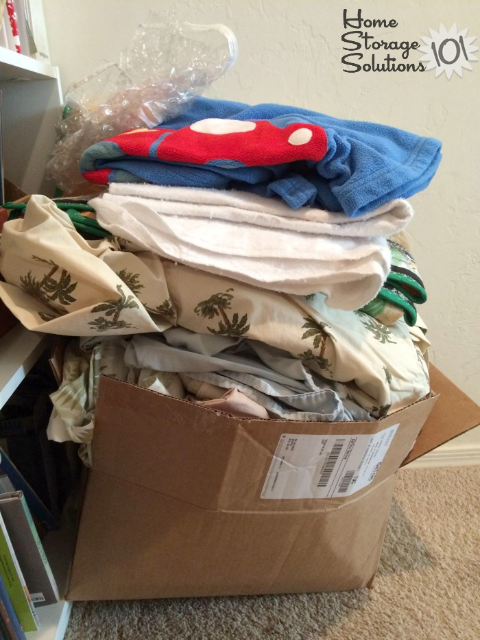 Box of bedding clutter that will be donated to a woman's shelter {part of the Declutter 365 mission to declutter blankets, on Home Storage Solutions 101}