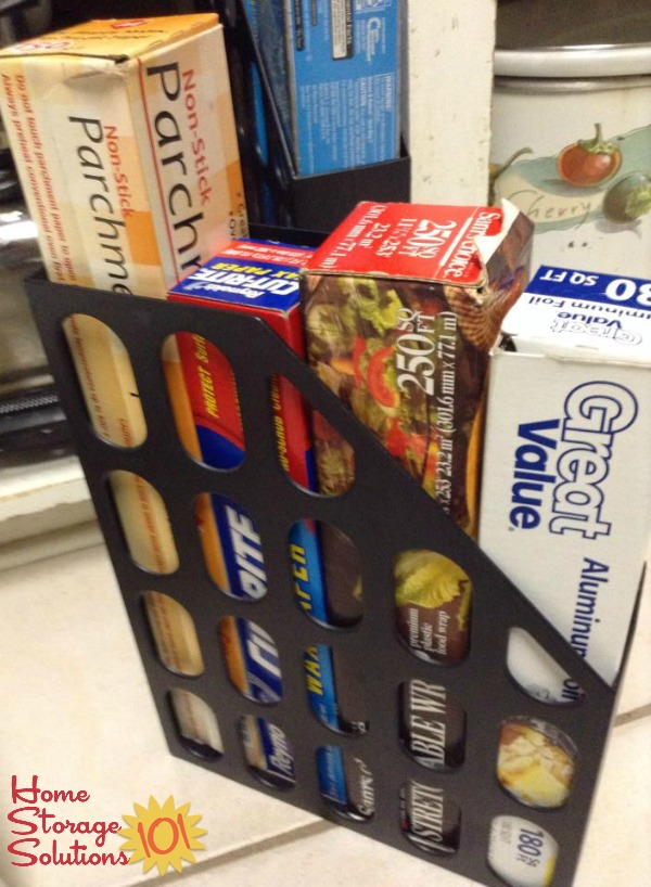 Use a magazine holder for organizing and storing your plastic wrap and aluminum foil rolls {featured on Home Storage Solutions 101}