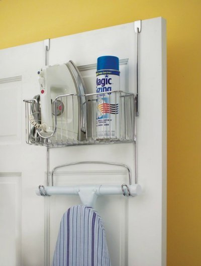 Over the door ironing board holder to keep your board and ironing supplies handy, but still out of the way while not in use {featured on Home Storage Solutions 101}