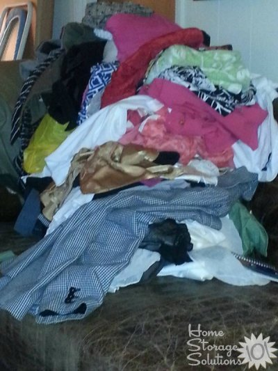 Pile of clothing clutter that Kathy is getting rid of {featured on Home Storage Solutions 101}