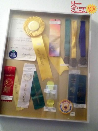 Display the ribbons, medals, trophies and other awards that you receive, or get rid of them if you have too much to actually enjoy and be proud of {#Declutter365 mission on Home Storage Solutions 101}