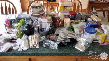 All of this stuff came out of one kitchen cabinet. That's why you should NEVER tackle more than one cabinet at a time when decluttering or you'll get overwhelmed.