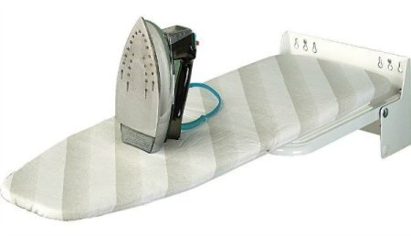 Wall mounted ironing board that folds out for use when you need it {featured on Home Storage Solutions 101}