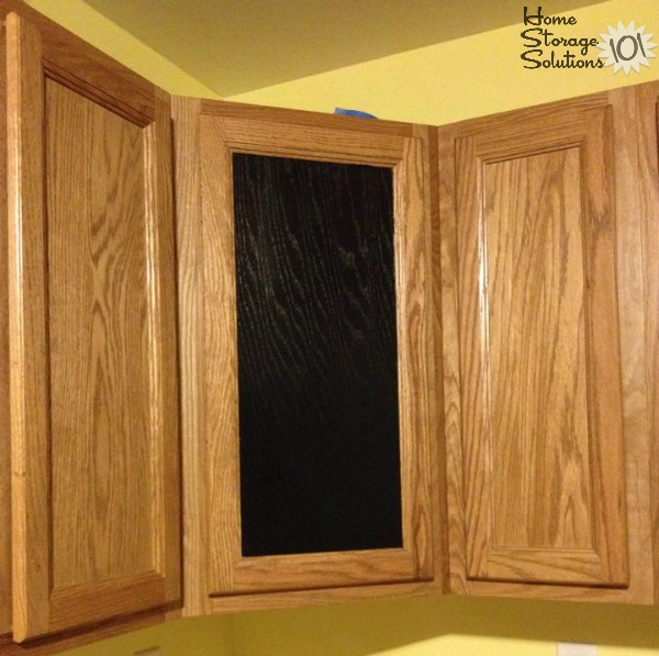 Use chalkboard paint on the front of a kitchen cabinet to have a built in way to write notes, such as your grocery list {featured on Home Storage Solutions 101}