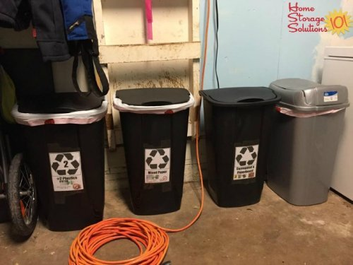 Recycle bins made from garbage cans, for sorting different types of recyclables {featured on Home Storage Solutions 101}