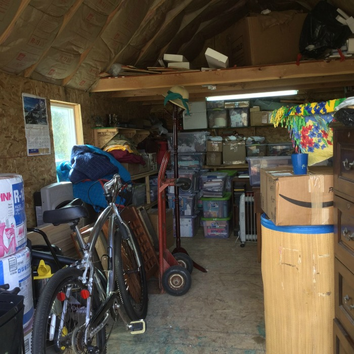 Cluttered storage shed, that is going to be decluttered and organized {on Home Storage Solutions 101}