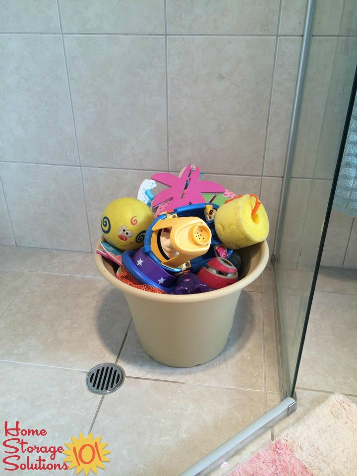 Use a flower pot, with holes in the bottom, to store bath toys {featured on Home Storage Solutions 101}