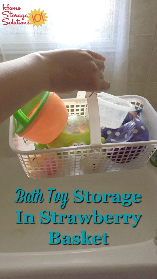 Use a small basket with holes for draining, such as a strawberry basket, for storing bath toys {featured on Home Storage Solutions 101}