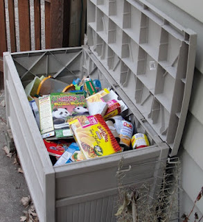 Large home recycling bin behind house