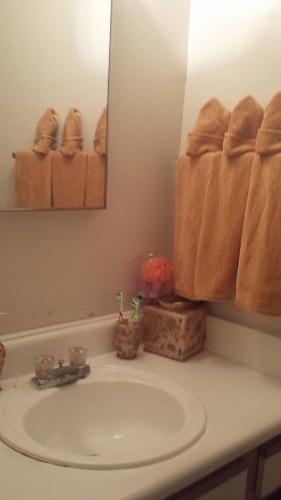 decluttered bathroom sink and countertop