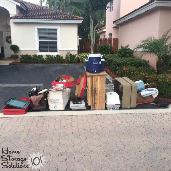 Large pile of bulk trash pickup of clutter removed from Beth's garage {featured on Home Storage Solutions 101}