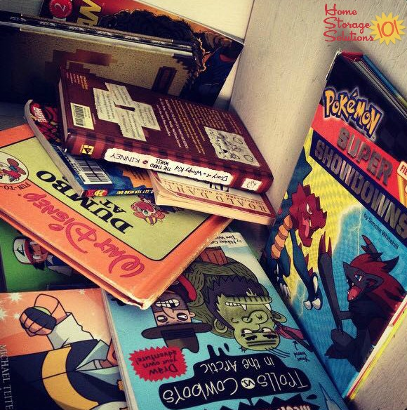 Cluttered stack of kids books by bedside of a child {on Home Storage Solutions 101}
