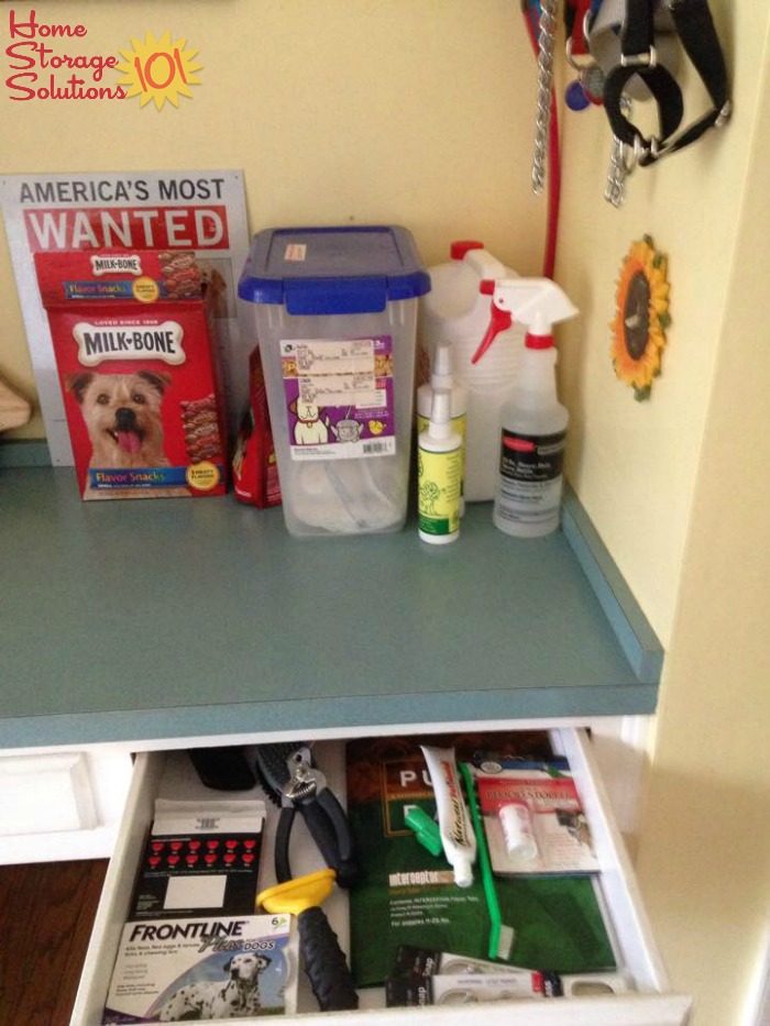 Decluttered and organized pet corner in kitchen, where keep pet related supplies {featured on Home Storage Solutions 101}
