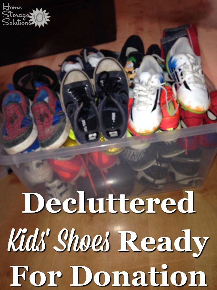 Decluttered kids' shoes ready for donation, from a reader participating in the Declutter 365 missions on Home Storage Solutions 101
