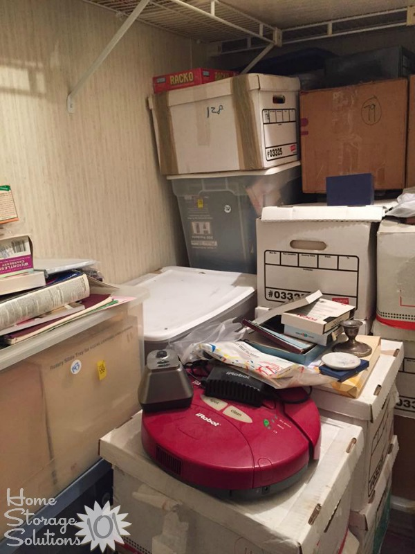 Another view during a decluttering project of a storage closet {on Home Storage Solutions 101}