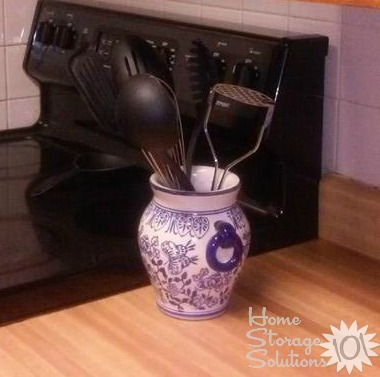 Repurpose an old vase to use as a utensil crock {featured on Home Storage Solutions 101}