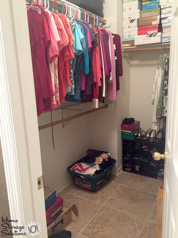 Organized and decluttered closet, after clearing the closet floor of clutter {featured on Home Storage Solutions 101}