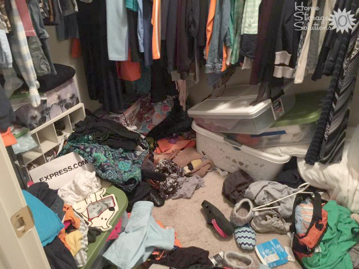 Closet floor that needs to be cleaned out and decluttered {featured on Home Storage Solutions 101}