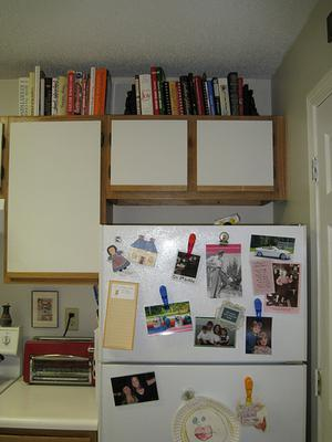 Display Cookbooks As Decorations Above Cabinets