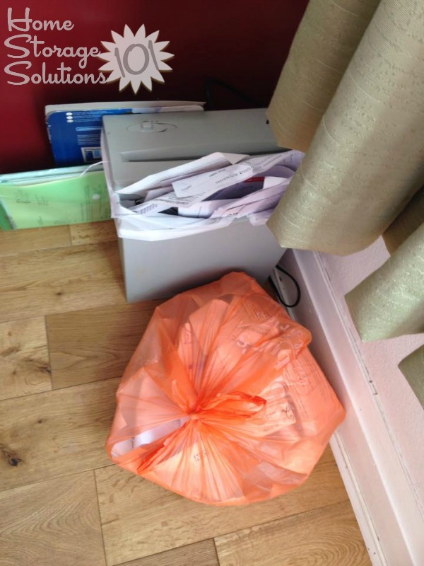 Sally's shredding and recycle piles after getting rid of junk mail {featured on Home Storage Solutions 101}