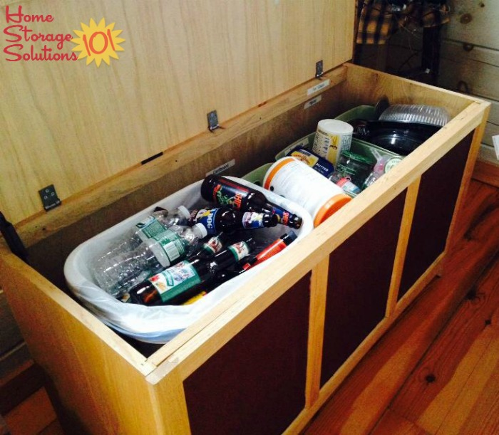 Recycling hidden within a storage bench in kitchen {featured on Home Storage Solutions 101}