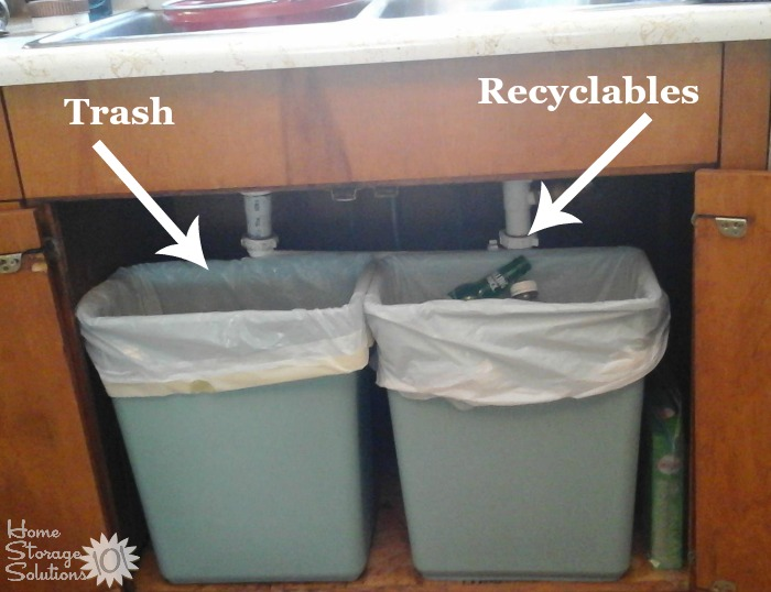 Separating trash and recyclables under the kitchen sink {featured on Home Storage Solutions 101}