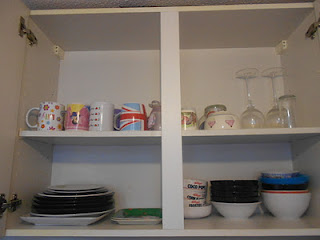 Organized cupboard with plates and bowls
