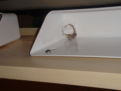Closeup up sink tray, to hold rings