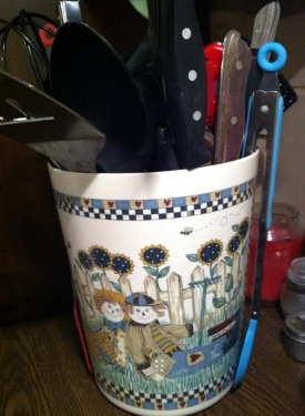 utensils held in unused small kitchen trash can