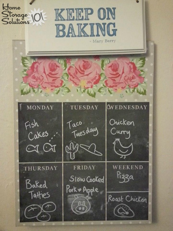 Chalkboard menu board with week's meal plan {featured on Home Storage Solutions 101}