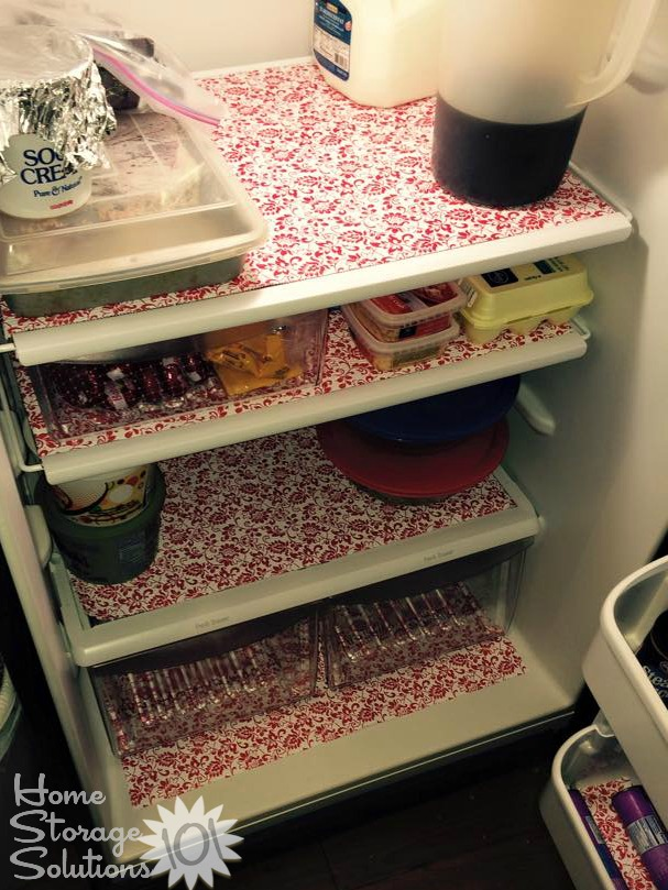 Refrigerator lined with shelf liner {featured on Home Storage Solutions 101}