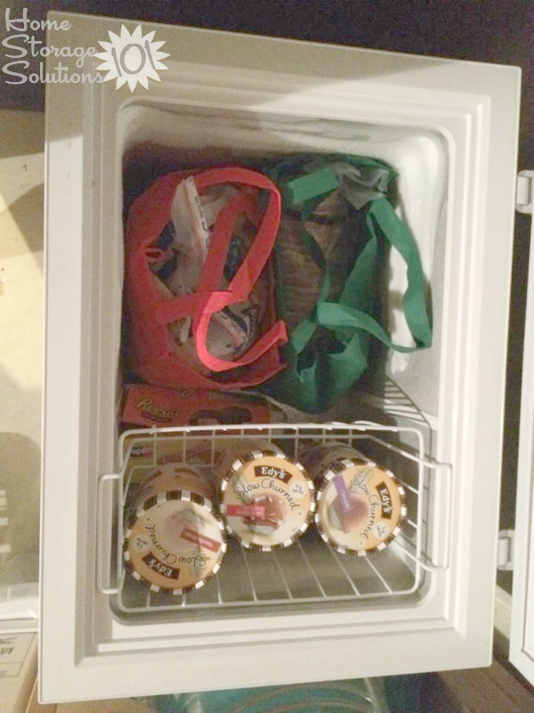Organize your chest freezer with reusable grocery bags, making it easy to lift out the bags as you need to retrieve something specific from inside {featured on Home Storage Solutions 101}
