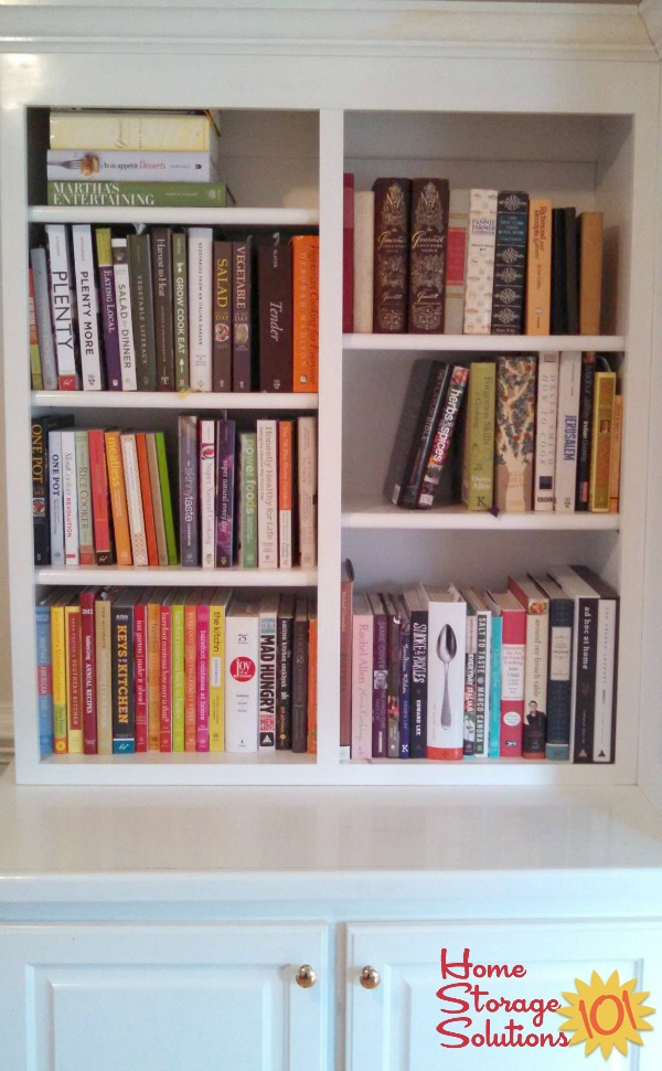 Organized bookshelf of cookbooks, with all books indexed to Eat Your Books to help find recipes to cook {featured on Home Storage Solutions 101}