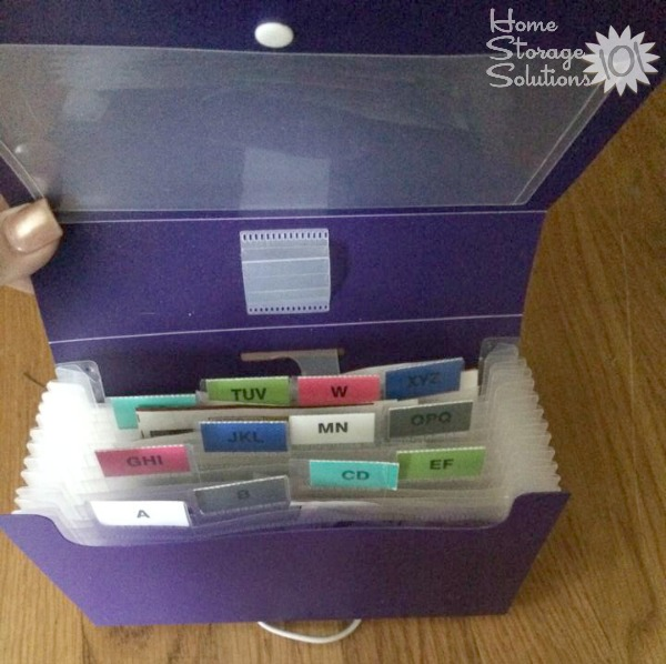 Organizing coupons using an accordion style folder {featured on Home Storage Solutions 101}