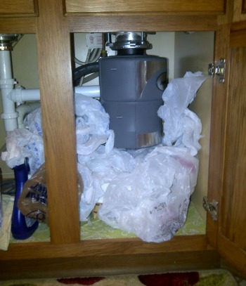 excess plastic grocery bags under sink
