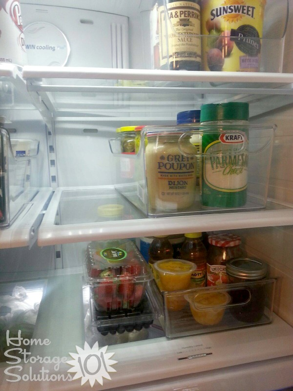 Use containers for refrigerator organization {featured on Home Storage Solutions 101}
