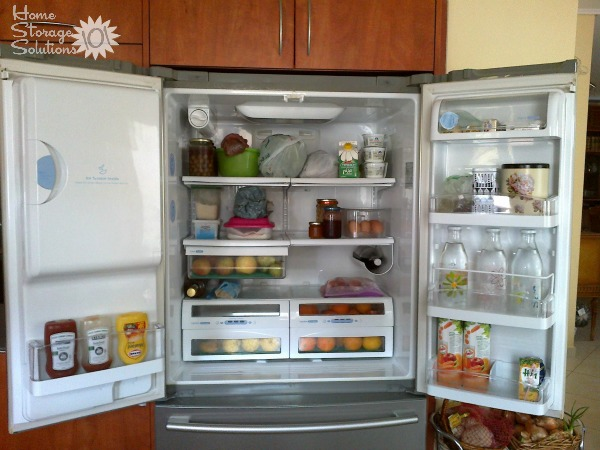 Organized refrigerator, including both the interior and doors {featured on Home Storage Solutions 101}
