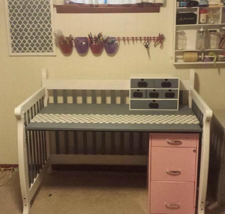 repurpose used baby crib into a desk