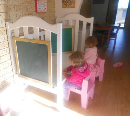 upcycle a used baby crib into a kids activity center