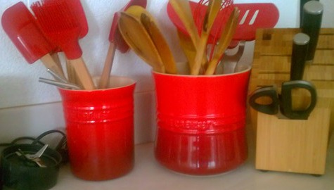 red Le Creuset utensil crocks